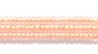 Seed Beads Czech Seed size 11 crystal w/peach color lined iridescent