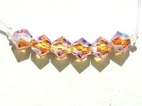 Swarovski Crystal Beads 6mm bicone 5328 light peach ab 2X transparent double iridescent