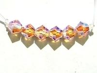 Image Swarovski Crystal Beads 6mm bicone 5328 light peach ab 2X transparent double iri