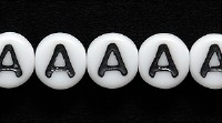 Image Czech Pressed Glass 6mm letter bead A white with black opaque