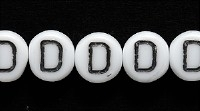 Image Czech Pressed Glass 6mm letter bead D white with black opaque