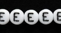 Image Czech Pressed Glass 6mm letter bead E white with black opaque