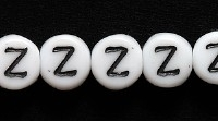 Image Czech Pressed Glass 6mm letter bead Z white with black opaque