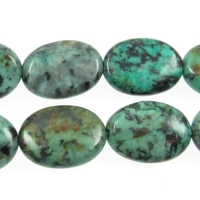 African Turquoise 10 x 14mm oval blue green with spots