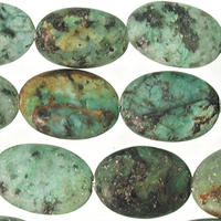 African Turquoise matte 10 x 14mm oval blue green with spots