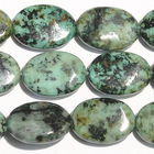 African Turquoise 13 x 18mm oval blue green with spots