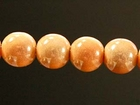 6mm round peach Miracle Beads
