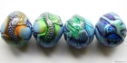 Mirage beads Mermaid's tale 19 x 16mm color changing