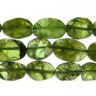 peridot appx 7 x 10mm flat oval green