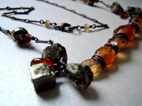 Sculpted Pyrite and Hessonite Gemstones