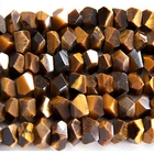 Tiger Eye 7 x 12mm faceted nugget rich golden brown