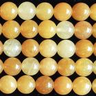 Image Yellow Jade 8mm round rich yellow